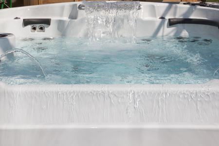 Detail of house garden spa falling water jet