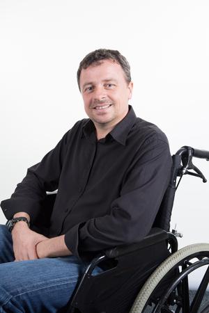 disabled handsome man in wheelchair paraplegic in white background