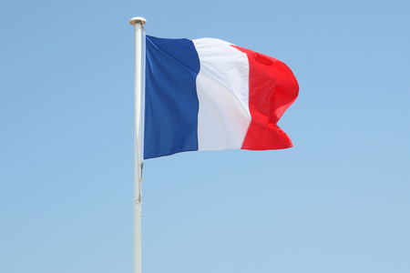 french France flag floats in the wind Standard-Bild