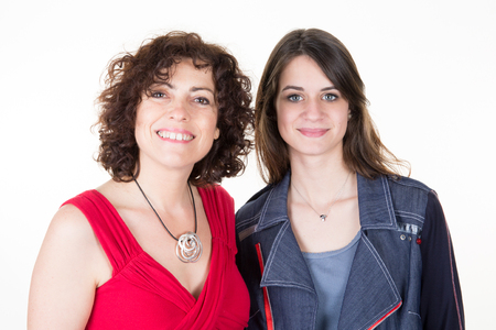 happy and smiling daughter and mother, studio shoot isolated on white Stock Photo