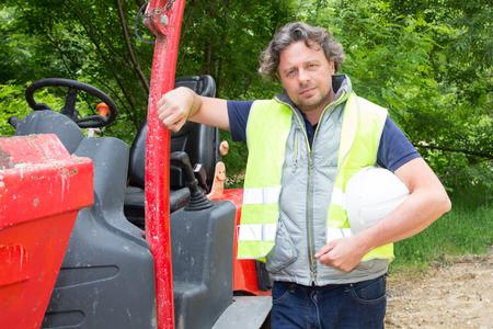 Construction worker man with Skid Steer Loader