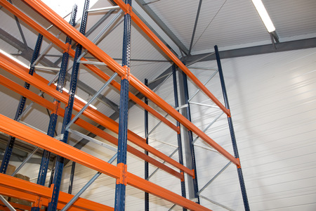 Pallet racking system equipment for warehouse shelves, racks blue orange Stock Photo