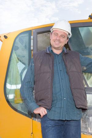 Smiling construction man manager standing on building site