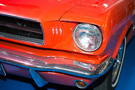 front face of an old car orange muscle car 写真素材
