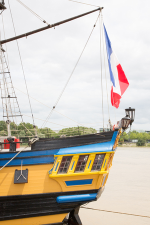 yellow and blue replica vessel with a france flag on the back Stock Photo