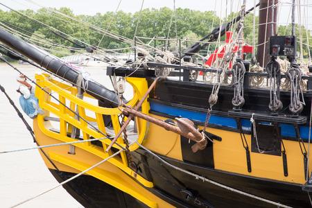 Ancient sailing ship boat in port sea Stock Photo