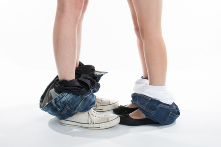 Young loving couple man and woman pants dropped down on their feet Romantic moment