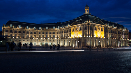 Bordeaux, Gironde / France - May 11 2018 : The finest bit of the riverfront is the Place de la Bourse, open to the river but enfolded on three sides by the Palais de la Bourse