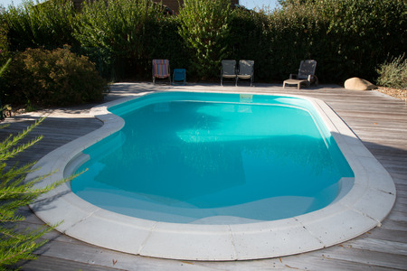 Oval swimming pool in a garden area beautiful park