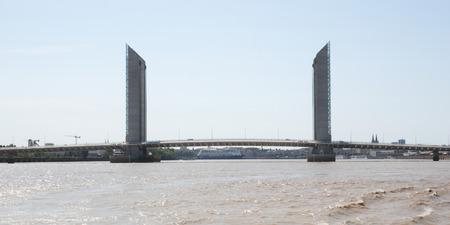 Bordeaux, Nouvelle aquitaine / France - 09 02 2018 : The Jacques Chaban-Delmas Bridge is a new vertical lift bridge in Bordeaux crossing the Garonne River Archivio Fotografico