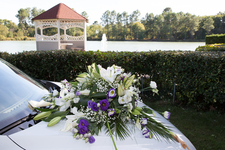 bouquet flowers on wedding white car in lake side