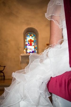 side detail view of wedding bride dress in church celebration
