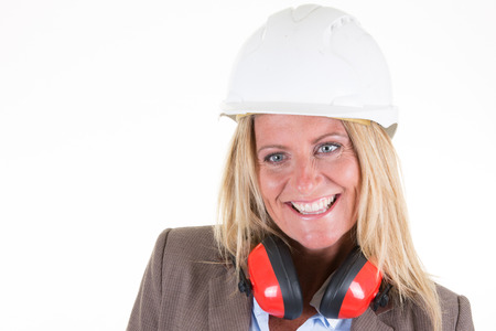 female middle aged female architect  warehouse worker with helmet safety