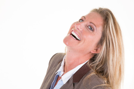 Close up portrait of beautiful middle aged woman businesswoman laughing against white background Stock fotó