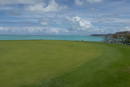 Stunning view of a green coastal golf course background of the sea