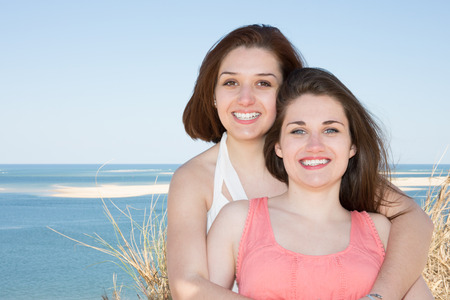Lesbian couple posing and dating on the beach vacation