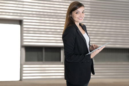 Portrait close up of young beautiful happy business woman in summer outdoors office headquarters