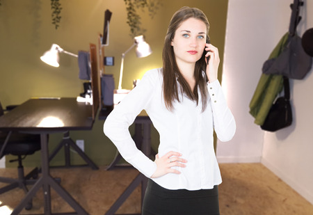 cheerful businesswoman in phone with customers at office pretty Stock fotó