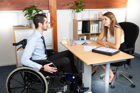 Disabled man having a business meeting with a businesswoman