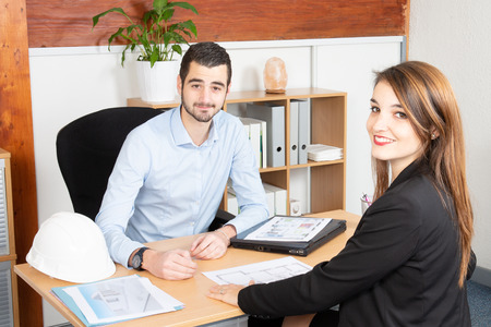 Attractive business people working in the office man and woman in business meeting 版權商用圖片