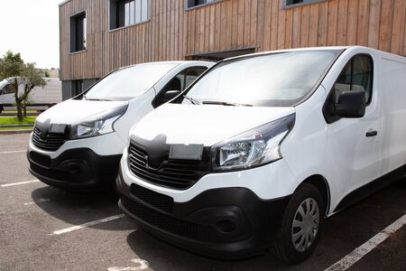 two white van front of warehouse reday for delivery parcel Stok Fotoğraf - 132114512