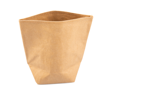 Recycled brown Paper kraft shopping bag isolated on a white background