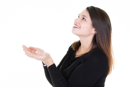 Profile of a happy woman looking up holding something blank Standard-Bild