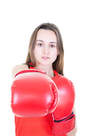 Young beautiful athletic woman hitting in boxing gloves with long hair Isolated white background 免版税图像