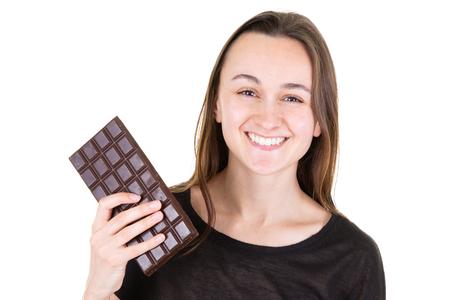Beautiful smiling girl holding before eating chocolate isolated on white background