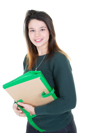 Young millennial girl college student holding folder on white background
