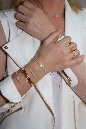Beautiful hands Female details With Jewelry on white clothes Standard-Bild
