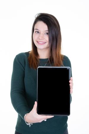Smiling woman showing blank black tablet computer screen Foto de archivo