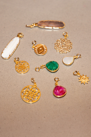 set of pendants jewelry on table background