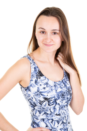 Young beautiful woman posing in new casual blue flowers dress