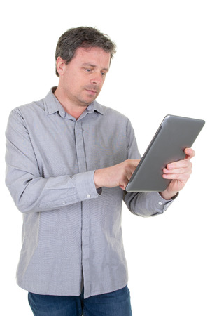 Trendy 40 year old man working looking with tablet on white background