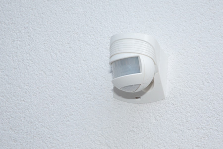 white detector for security system motion sensor on wall