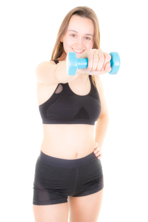 blurred woman in gym exercising with blue dumbbells Stock Photo