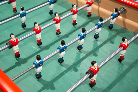 Close-up of Table football soccer game on green field baby foot
