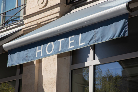 Hotel sign at the entrance of cozy accommodation