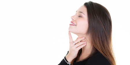 Beautiful young woman cares for the neck