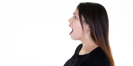 Closeup side view profile portrait young woman talking yelling with open mouth Banque d'images
