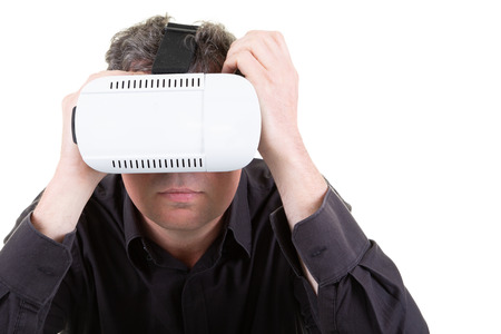 portrait of man using a virtual reality headset isolated in white concept VR 版權商用圖片