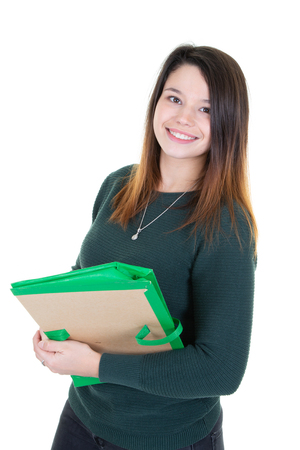 Happy student girl poses looking at camera in white background