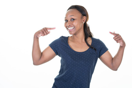 african american pretty young woman over isolated background looking confident with smile on face pointing oneself with fingers proud and happy Stockfoto - 121643063