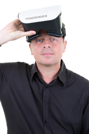 handsome man with virtual reality goggles on hands 版權商用圖片