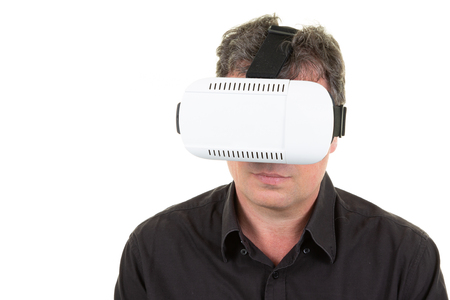 Businessman with VR headset on head in studio photo on white background Virtual reality gestures 写真素材