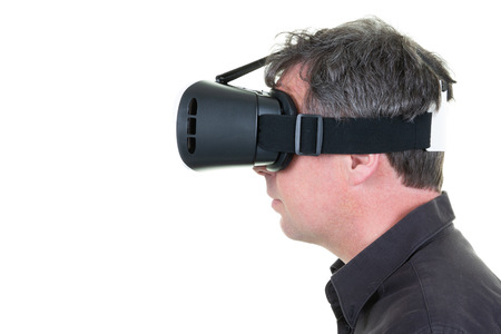 Profile pleasant cheerful man using virtual reality device