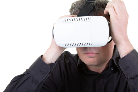 Close up man in 3d headset watching something fascinating and surprising while experiencing virtual reality vr glasses