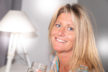 happy smiling middle aged woman cute blonde happy at home
