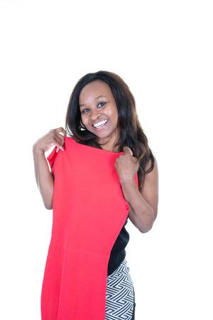 Beautiful young woman african american choosing dress Banco de Imagens